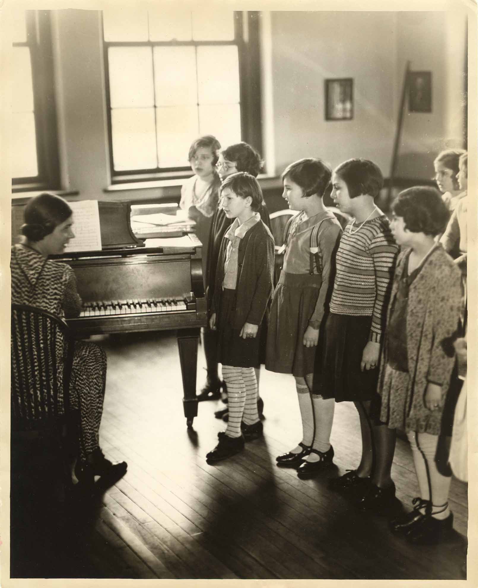 Historic photo of choir rehearsal at Settlement