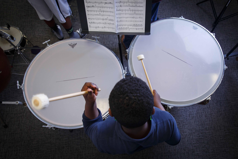 Settlement student playing timpani