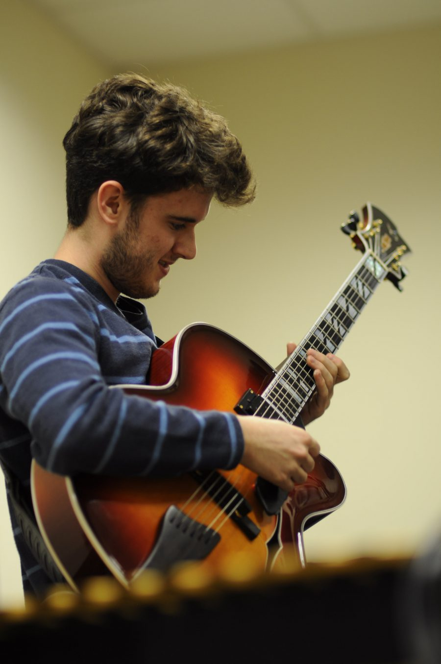 A guitar student rehearses at Settlement