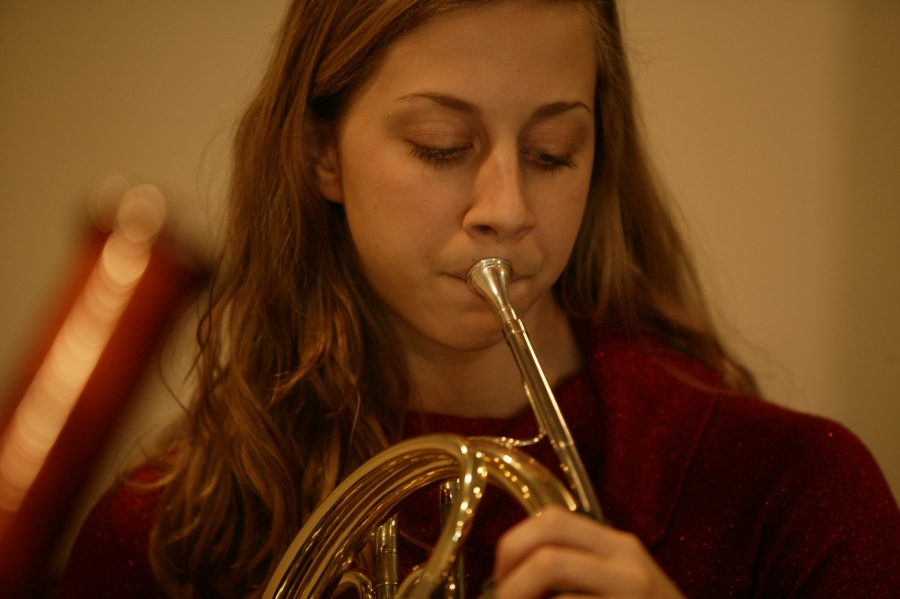 Settlement student plays french horn