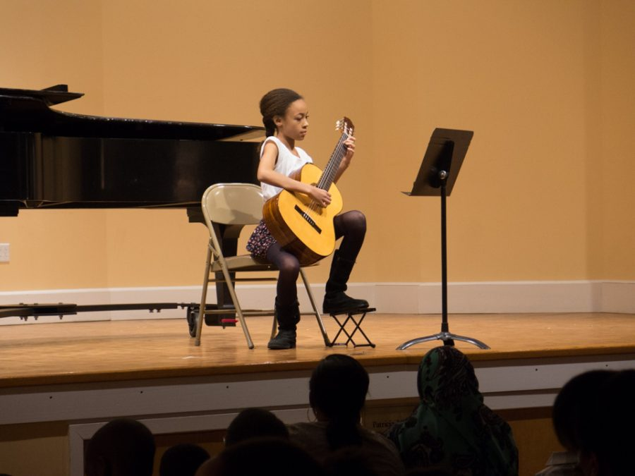 A student performs at the Germantown Branch