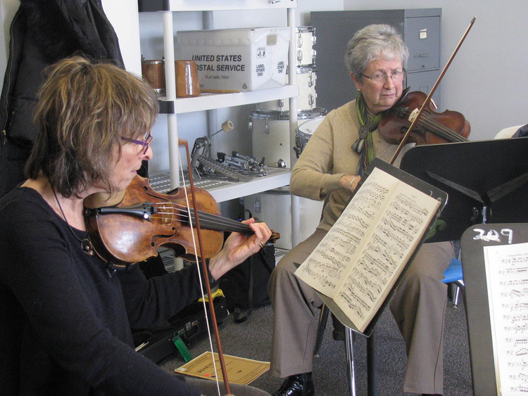 Adult Orchestra students rehearse at Settlement.