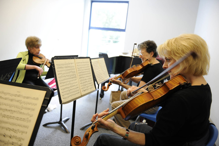 Adult Orchestra students rehearse at Settlement Music School.
