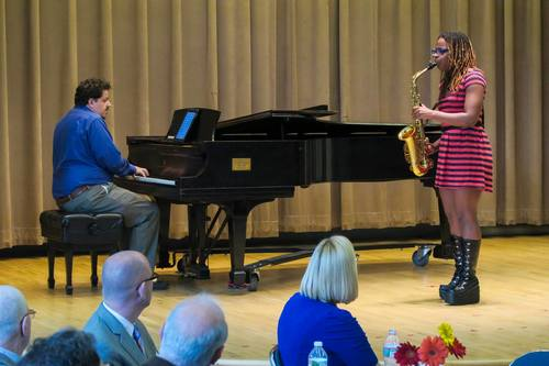 A Settlement student performs at Settlement's Annual Meeting