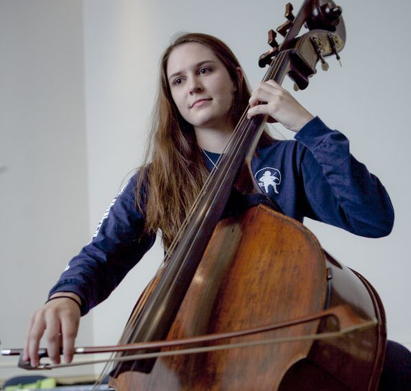 Settlement student playing double bass