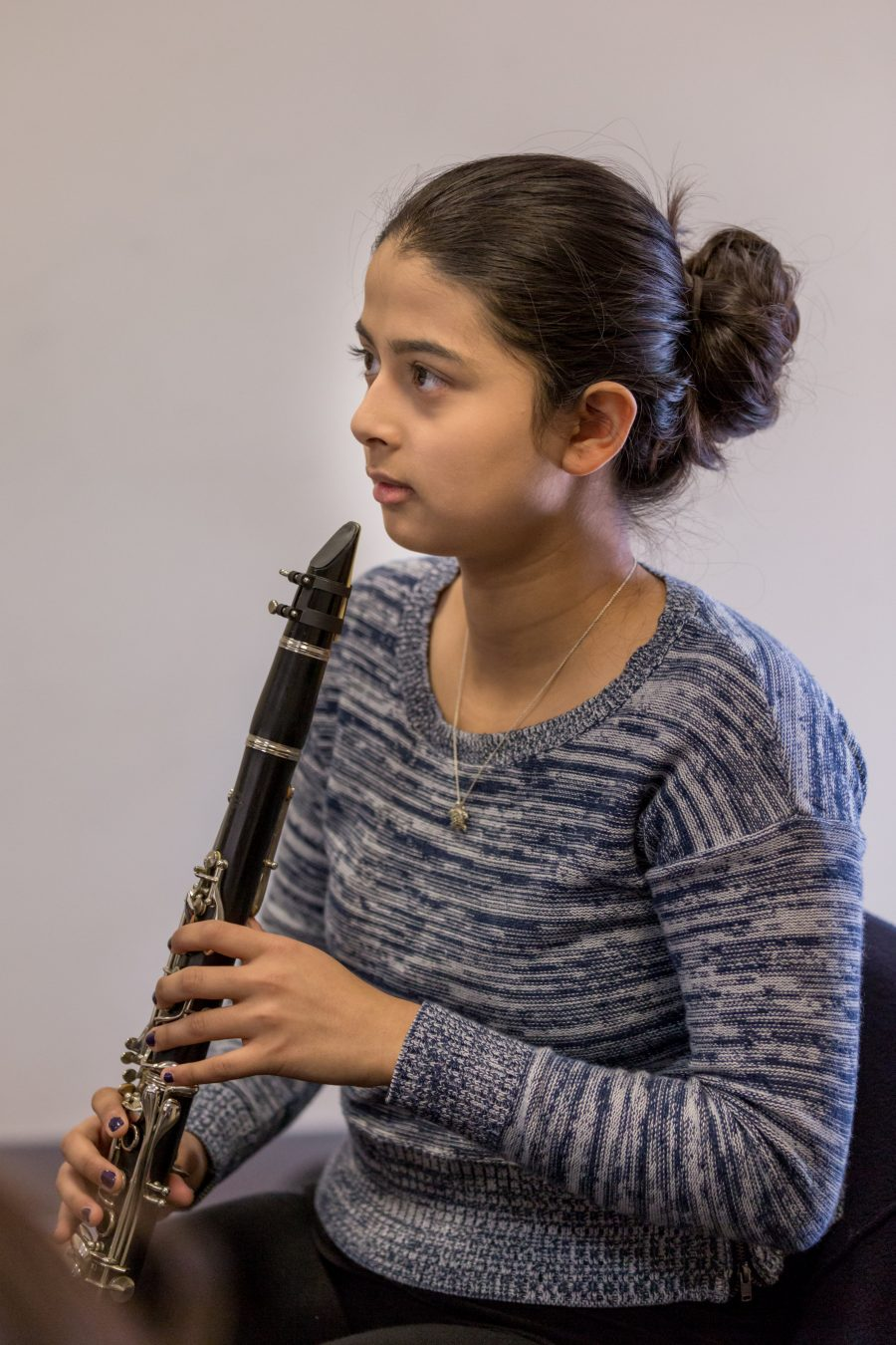 Settlement student plays the clarinet