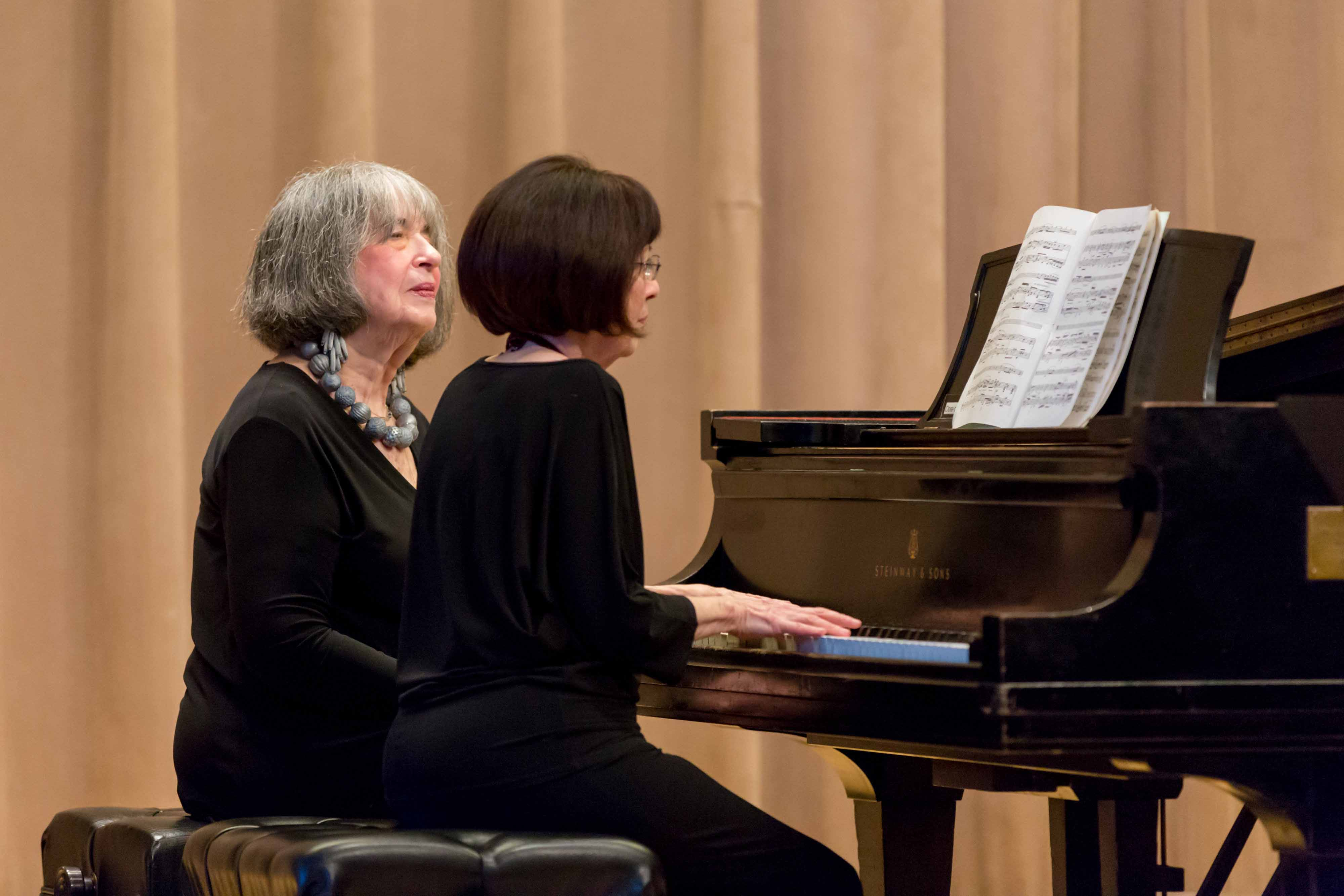 Leah Mellman and Libby Harwitz perform on stage