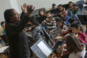 Ensemble students rehearse for an upcoming performance