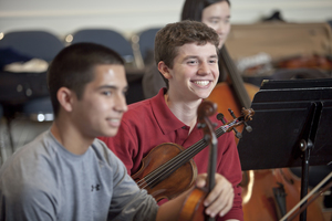 Ensemble students share a laugh at Settlement Music School