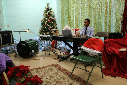 Settlement jazz students perform at a community holiday event