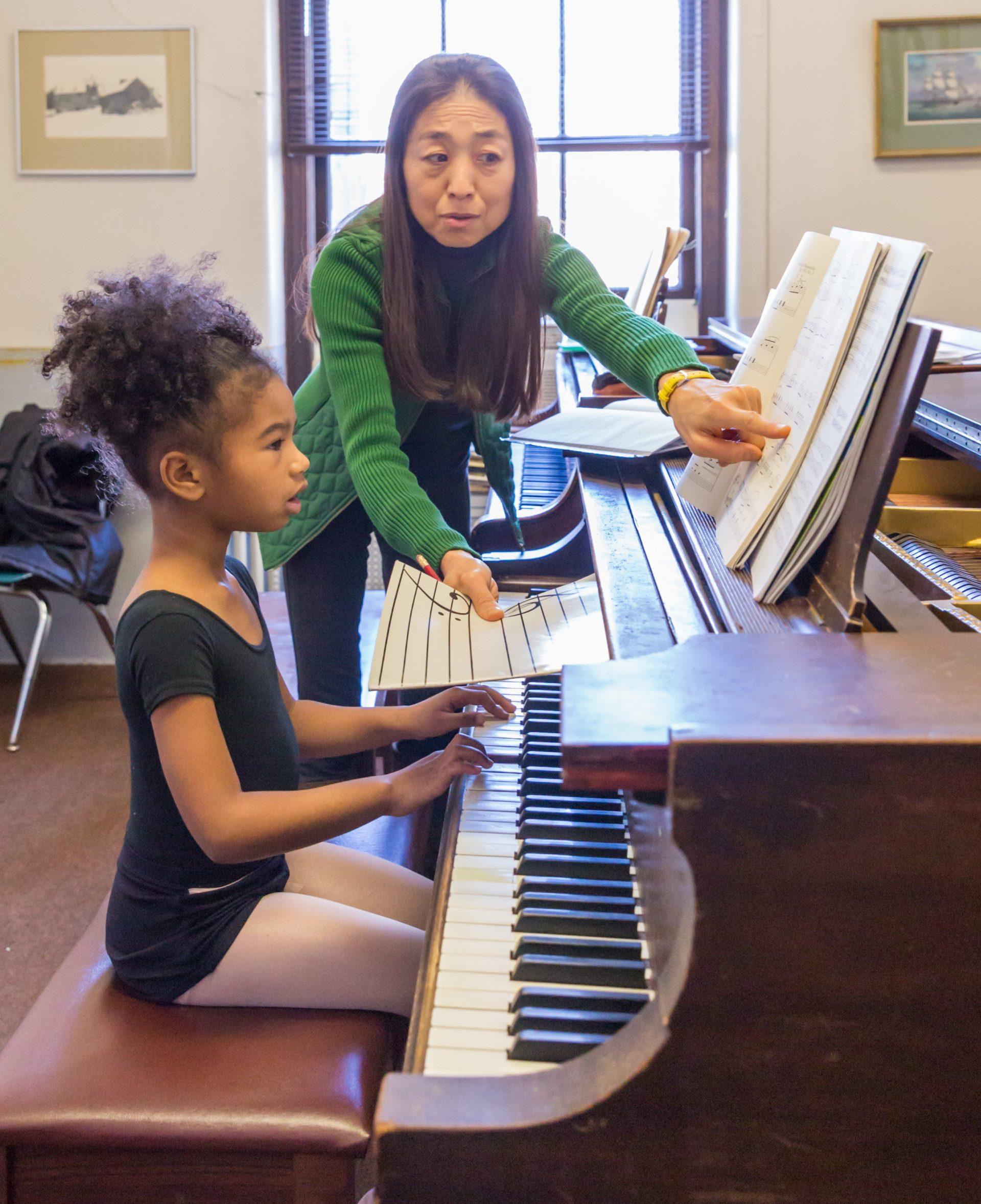 Settlement piano instruction