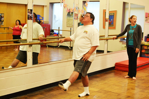 An arts therapy student participates in a dance class