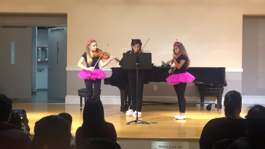 Settlement students perform at a Halloween-themed event