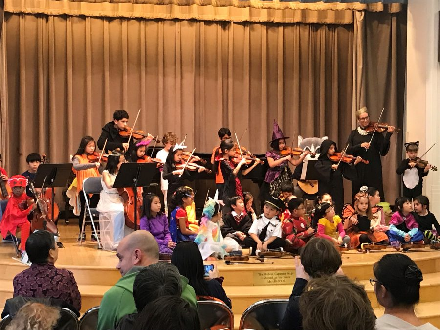 Settlement students perform during a Halloween-themed performance.