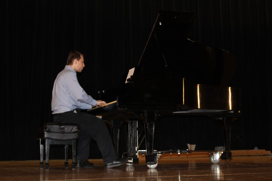 A student performs at the Camden Open House