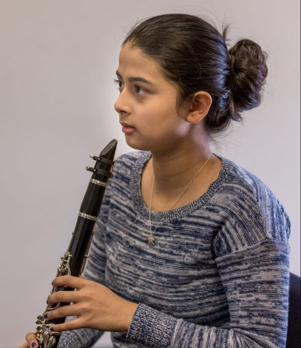 A Settlement student rehearses clarinet