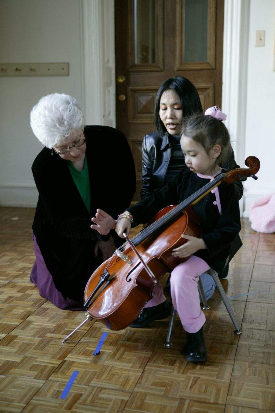 A young Suzuki student learns the cello.