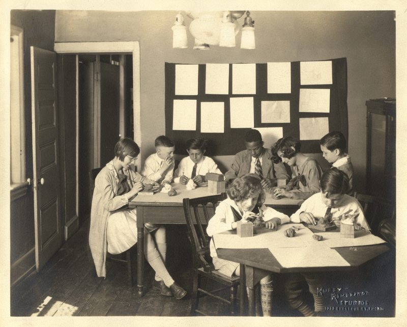 A historic photo of a young Settlement class.