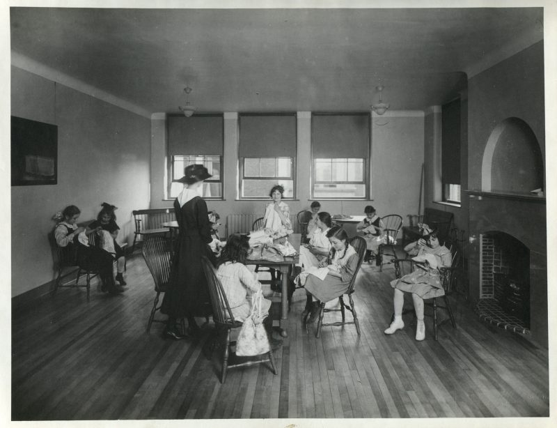 A historic photo of a sewing class at