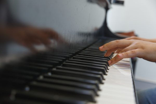 A Settlement Music School student practices piano