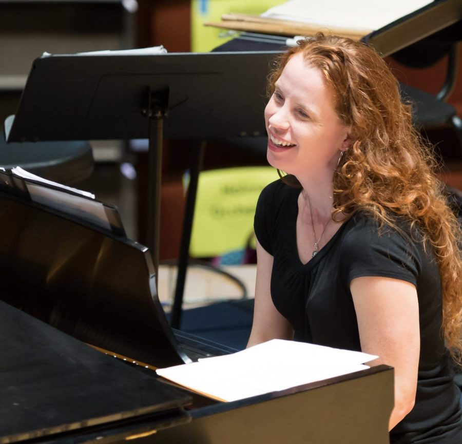 Settlement's Director of Education, Karin Orenstein, plays piano for a Music Education Pathways rehearsal