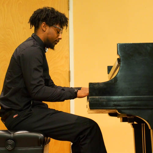 Doug Darden performs at the piano of Settlement's Germantown Branch