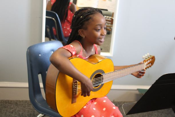 A guitar lesson during our Germantown Branch's Open House.