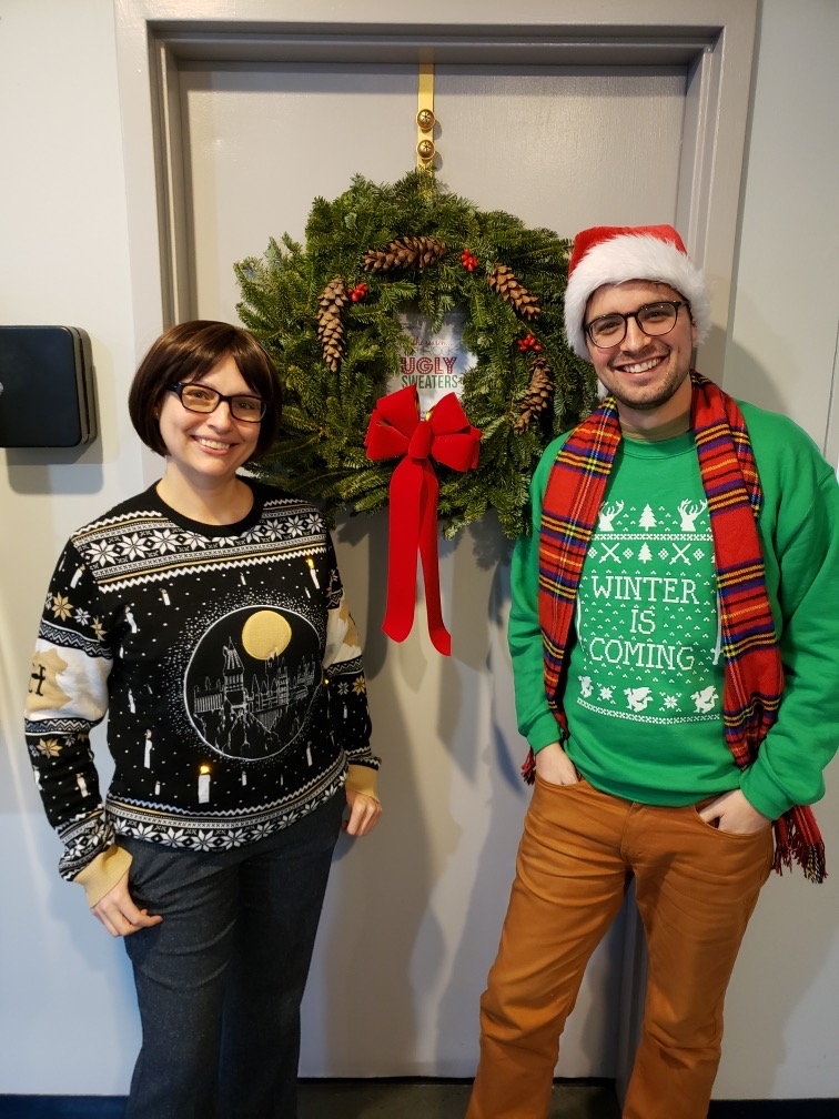 Germantown Branch staff show off their cring-worthy holiday sweaters
